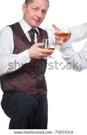 A man with a glass of brandy in his hand on a white background