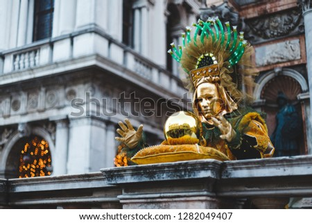 A man with a golden ball at the Venice Carnival 2018. #1282049407