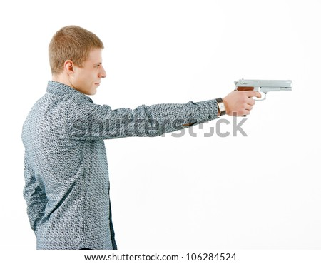 a man with a gun aiming at the distance. profile