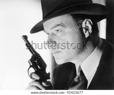 A man with a hat and gun