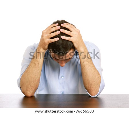 A man with a headache at the desk, isolated on white background