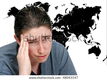 a man with a headache thinking about the world's problems in front of a black map on white - stock photo