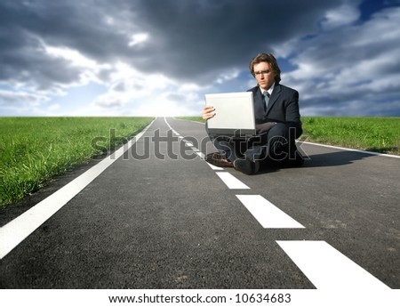a man with a laptop on the street #10634683
