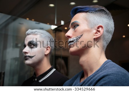 A man with a make-up for Halloween #334529666