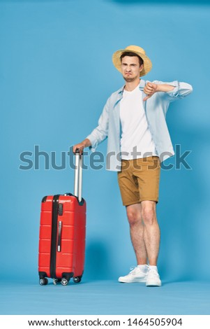 A man with a red suitcase trip vacation tourism vacation flight