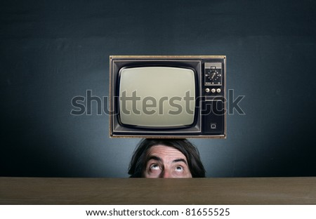 A man with a retro TV on his head.