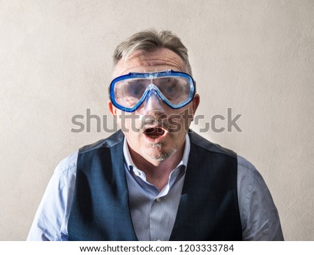 a man with a scuba mask #1203333784
