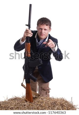 A man with AKM (Avtomat Kalashnikova) Kalashnikov