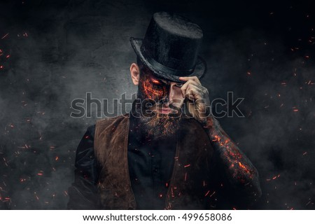 A man with burning face and arm in fire sparks.