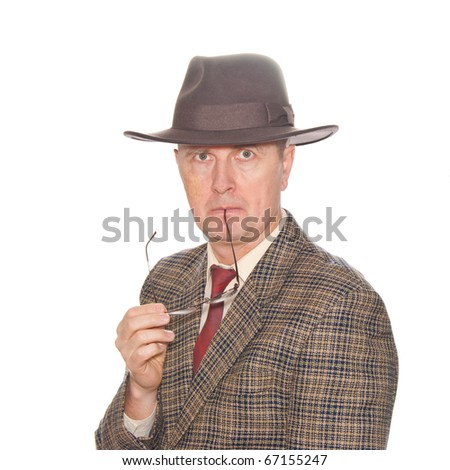 A man with eyeglasses in suit and hat isolated on white.