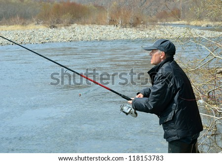 A man with spinning rod on fishing. #118153783