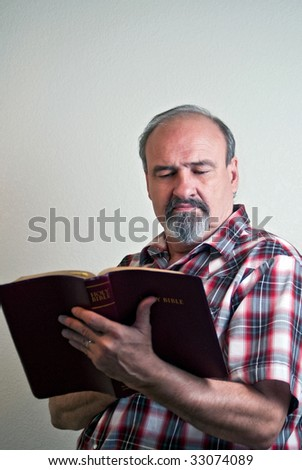 A man with strong convictions studies a bible