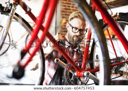 a man working in a bicycle...