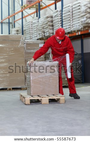 A man working in a warehouse.