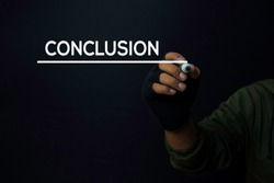 A man write a conclusion with a black background