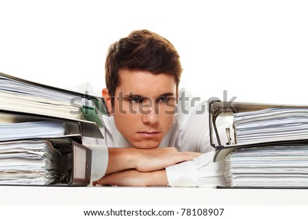 A manager in the stress with stacks of files. Bureaucracy in administration