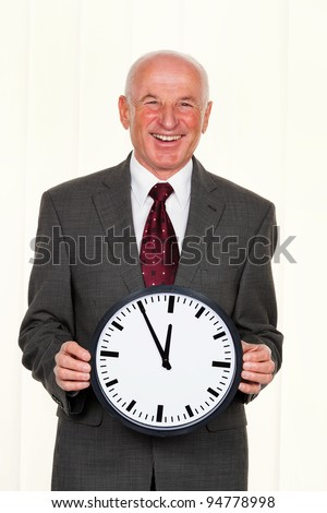 a manager keeps a clock. on the dial, it is 11:55