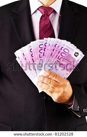 A manager with lots of 500 euro bills in his hand. - stock photo