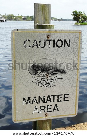 A Manatee Caution sign helps protect the endangered West Indian manatees from motorized boats in the Homosassa River, Florida.