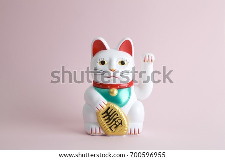 a Maneki-neko plastic cat, Symbolizing luck and wealth, on a pop and colorful background.\rMinimal color still life photography