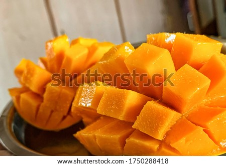 A mango is a juicy stone fruit produced from numerous species of tropical trees belonging to the flowering plant genus. Photo stock ©