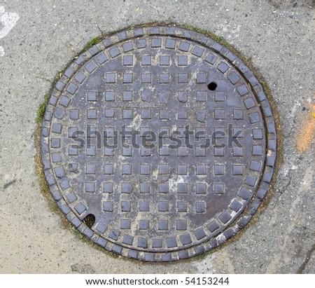 A Manhole Cover in Half Moon Bay, CA