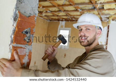 a manual worker with a sledgehammer