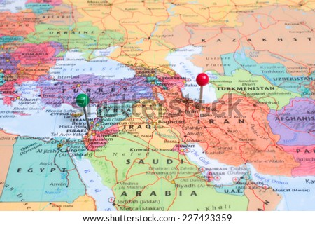 A map with a green map pin placed at Israel, and a red map pin placed at Tehran, Iran