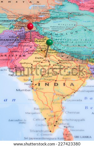 A map with a red map pin placed at Islamabad, Pakistan and a green map pin in Delhi, India.