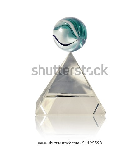 A marble on the top of a glass pyramid - balance concept