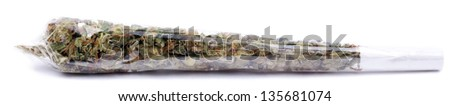 A marijuana joint rolled with transparent rolling paper, ready for use. Isolated on white.