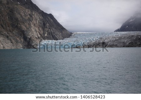 A marine terminating glacier in Greenland is rapidly thinning and melting as ocean and air temperatures warm