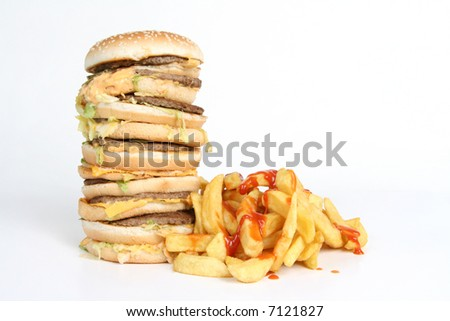 A massive burger with fries covered in ketchup