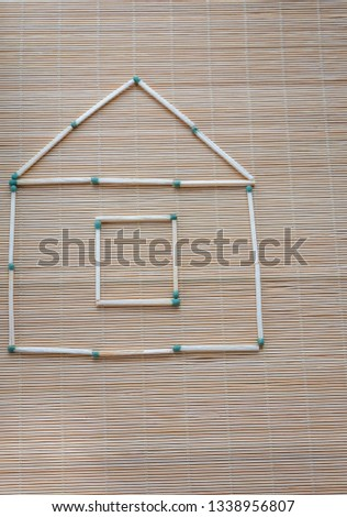 A match house on a table on a light natural background, a hobby at leisure, symbolic fantasy #1338956807