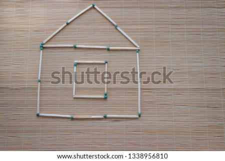A match house on a table on a light natural background, a hobby at leisure, symbolic fantasy #1338956810