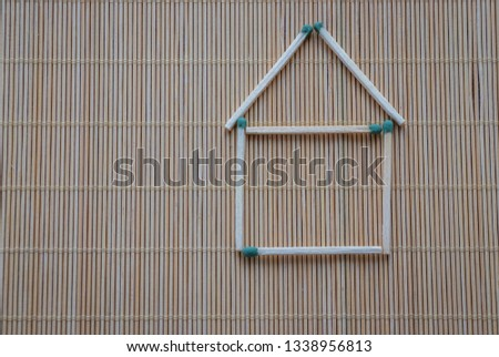A match house on a table on a light natural background, a hobby at leisure, symbolic fantasy #1338956813