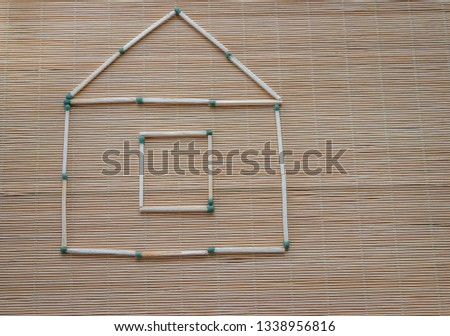 A match house on a table on a light natural background, a hobby at leisure, symbolic fantasy #1338956816