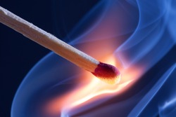 A match take fire and causes smoke emission