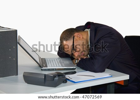 a mature African-American businessman having a power nap in his office, isolated on white background
