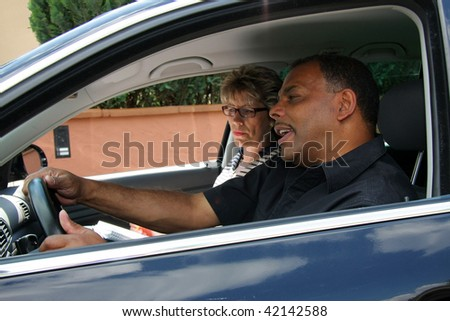 a mature African-American man having a driving test and being stressed out by the tester