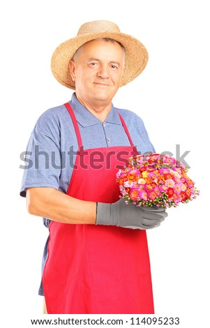 A mature gardener holding a bouquet of flowers isolated on white background