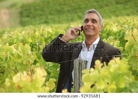 stock photo a mature man over the phone in a vineyard 92935681 stock photo : Indian mature business man with mobile phone