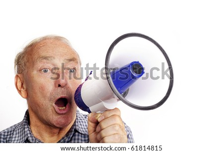 A mature man shouting through a bull horn isolated against white background.