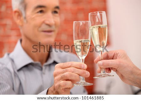 A mature man toasting.