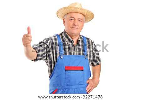 A mature smiling farmer giving a thumb up isolated against white background