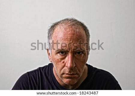 a Mean Looking Man Staring