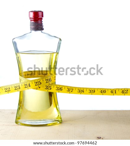 A measuring tape around a bottle of olive oil, health food concept