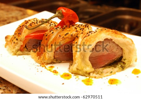 A meat dish with pastry at a restaurant
