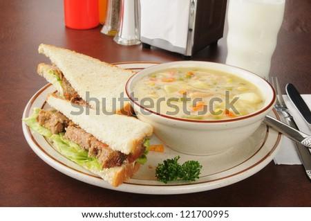 A meatloaf sandwich with chicken dumpling soup