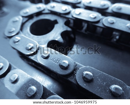A mechanical chain on a gear taken out of a cnc machine